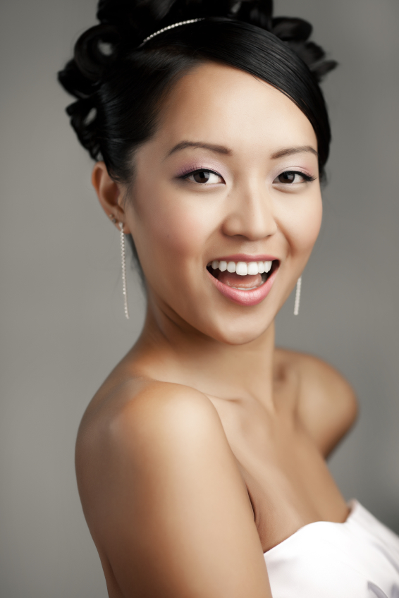 Dentist Beverly Hills Cosmetic Dentistry Giri Palani DDS Asian woman in white dress smiling